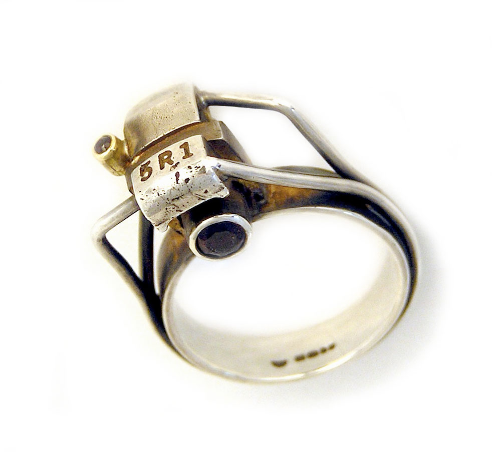 Anastasia Young. Ring: '5R1' Ring, 2009. Patinated sterling silver, 18ct yellow gold, garnets, ruby. 3 x 2.2 x 1.2 cm.