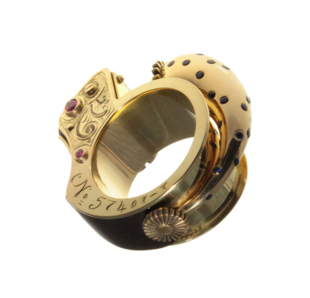 Anastasia Young. Ring: Music Box Ring, 2008. 18 ct yellow gold, sapphires, rubies, ebony. 3.5 x 3.5 x 1.5 cm.