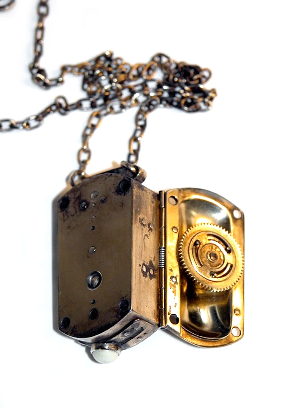 Anastasia Young. Necklace: Switch Locket #2, 2004. Gold plated sterling silver, stainless steel, bone. 2 x 1.2 x 5 cm.