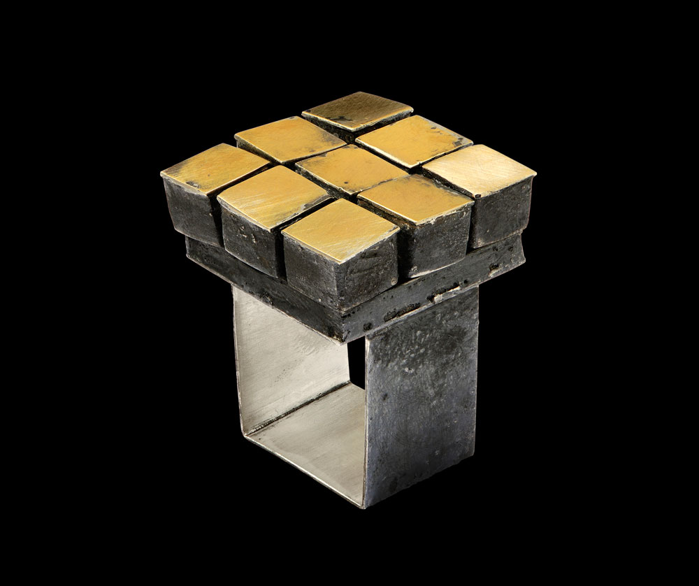 Gigi Mariani. Ring: Mobile, 2015. Silver, 18kt yellow gold, niello patina. 2,7 x 2,7 x 3,3 cm. Photo by: Paolo Terzi.