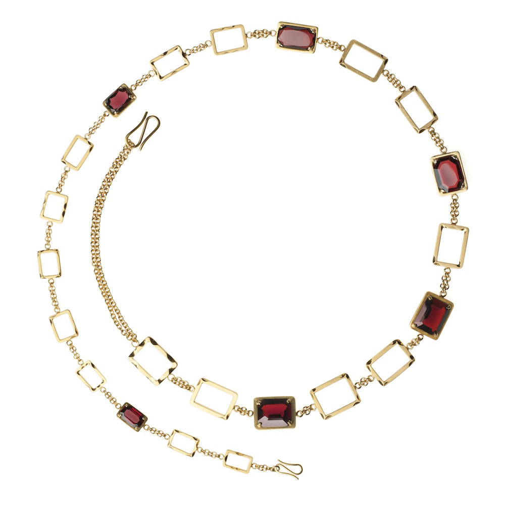 Anastasia Young. Necklace: Garnet Chain, 2015. Gold vermeil on sterling silver, garnets. 61 x 1.2 x 0.5 cm. Photo by: Lindsay Cameron. From series: The Lily Holds Firm and Other Tales.