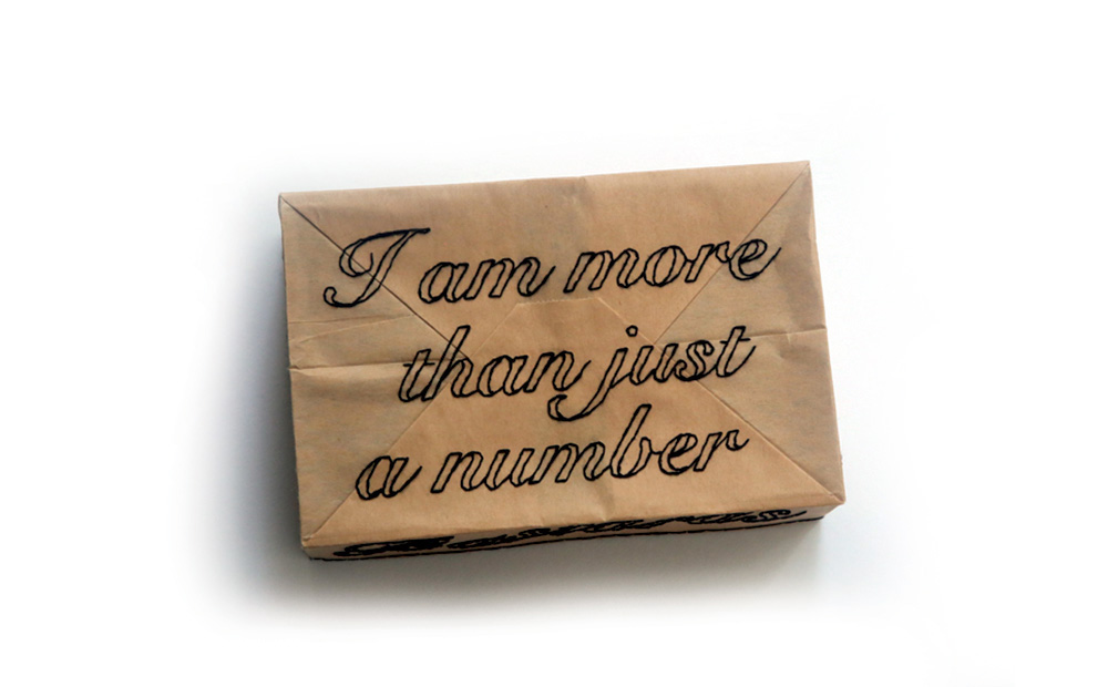 Lucy Ganley. Brooch: I am more, 2017. Paper bag, cotton thread, silver, steel wire, masking tape. 15 x 10 x 5 cm. Awarded at: JPLUS Graduate Award 2017 by Klimt02.
