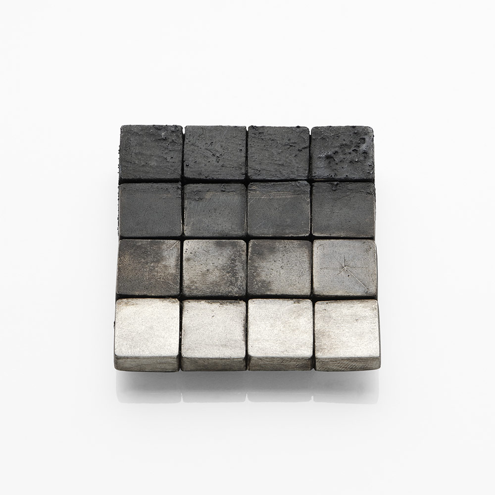 Gigi Mariani. Brooch: Black/ White, 2019. Silver, niello, patina.. 4 x 4 x 0.3 cm. Photo by: Paolo Terzi. From series: Di-segno.