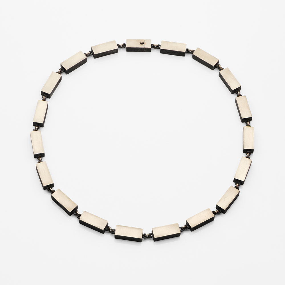 Gigi Mariani. Necklace: White gold Pebbles, 2019. Silver, 18kt white gold, black rodium patina.