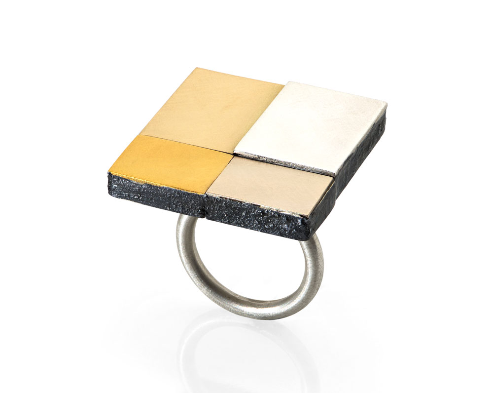Gigi Mariani. Ring: Colors, 2019. 18kt white gold, 18kt yellow gold, pure gold, silver, niello.